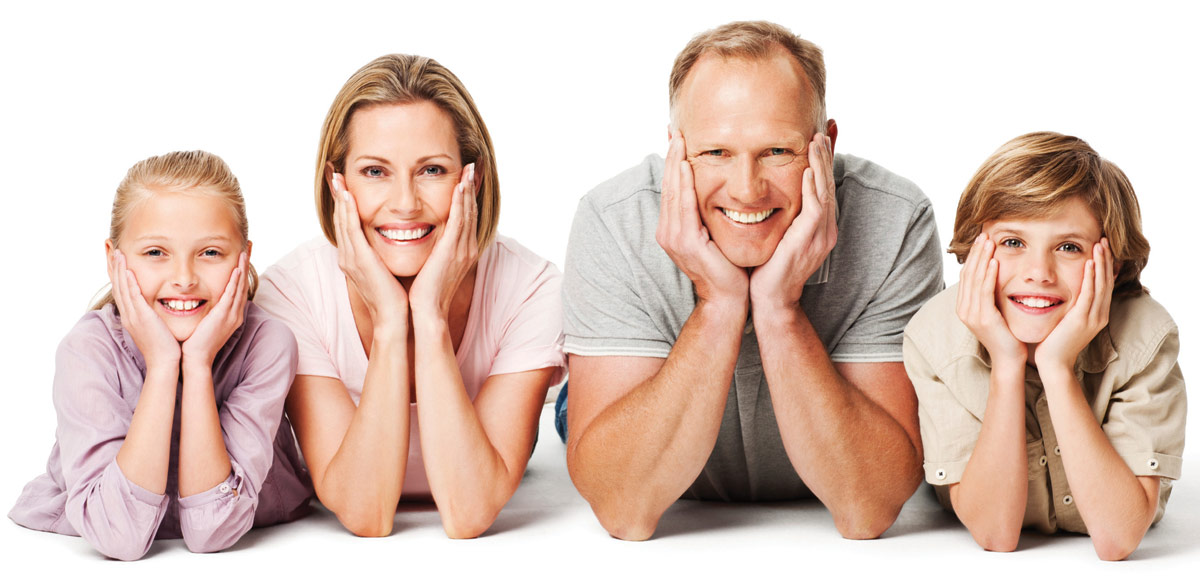 smiling family with faces in hands